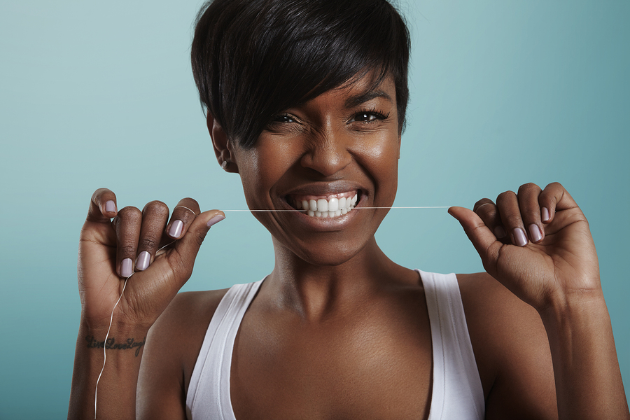 happy girl have fun with a tooth floss. tooth care. white smile