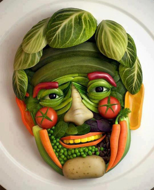 Shape of man's face made out of vegetables