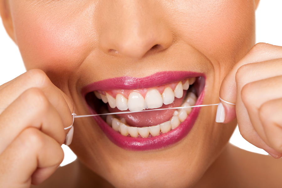 In addition to regular dental visits, keep teeth clean with floss